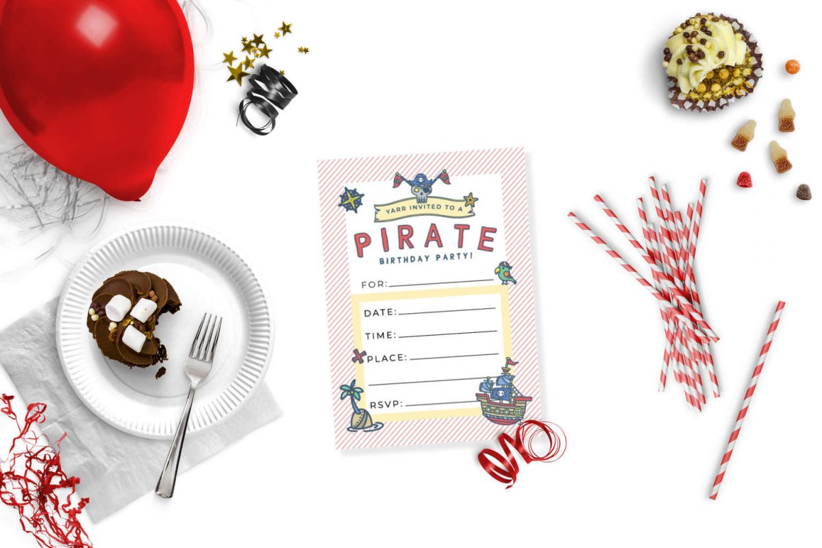 Free printable cute pirate party invitation on a table with cake, balloons and sweets