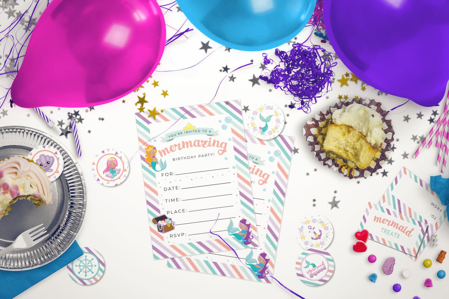 Free Mermaid birthday party printables lying on a decorated table
