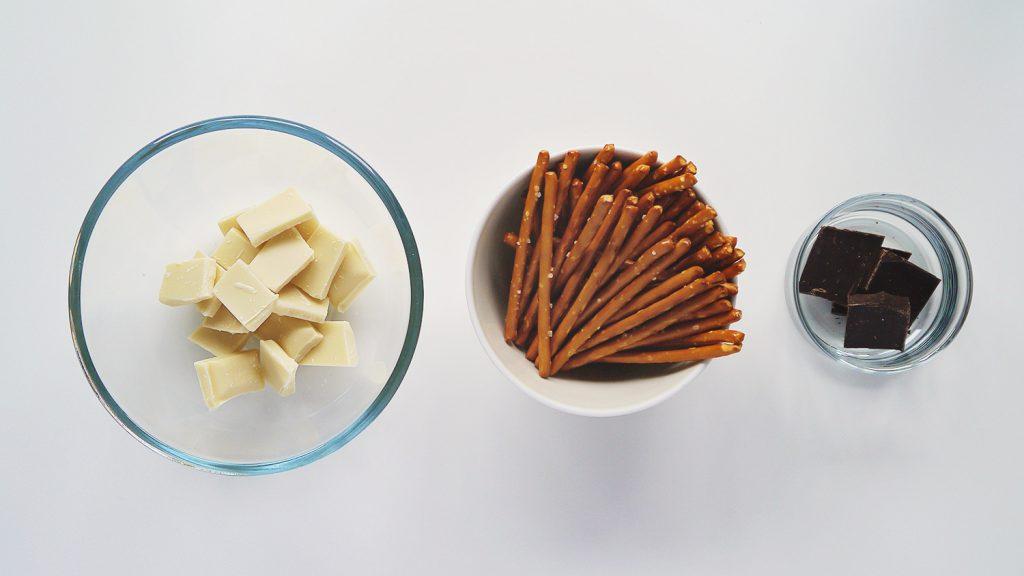Halloween chocolate pretzel spider web ingredients: white chocolate, pretzel rods and a little dark chocolate (optiona)