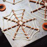 White chocolate and pretzel spider web treats for Halloween