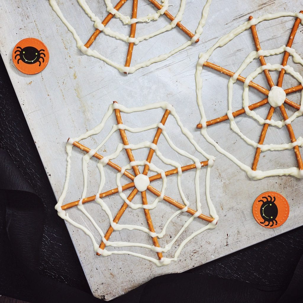 White chocolate and pretzel spider web candy for Halloween