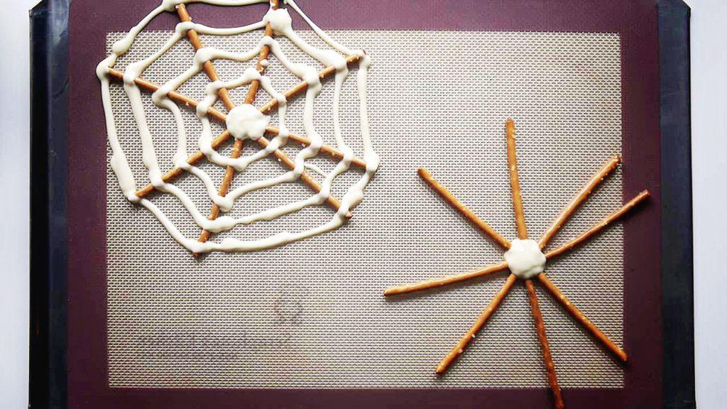 making halloween pretzel spider webs