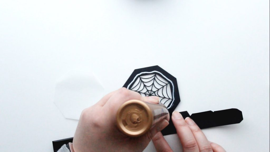 apply glue to the inside edge of the spider web lid border