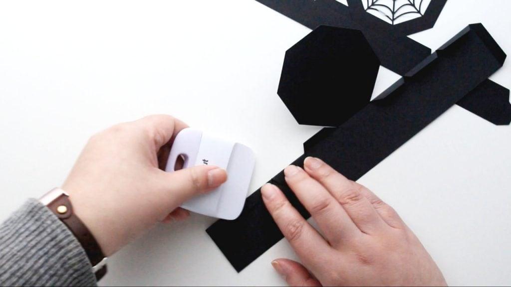 fold along the score lines and burnish with a Cricut scraper or bonefolder for neat, crisp edges