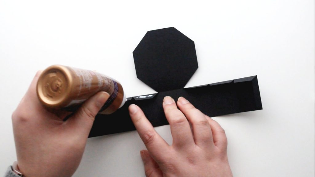 apply glue to the tabs of your treat box base