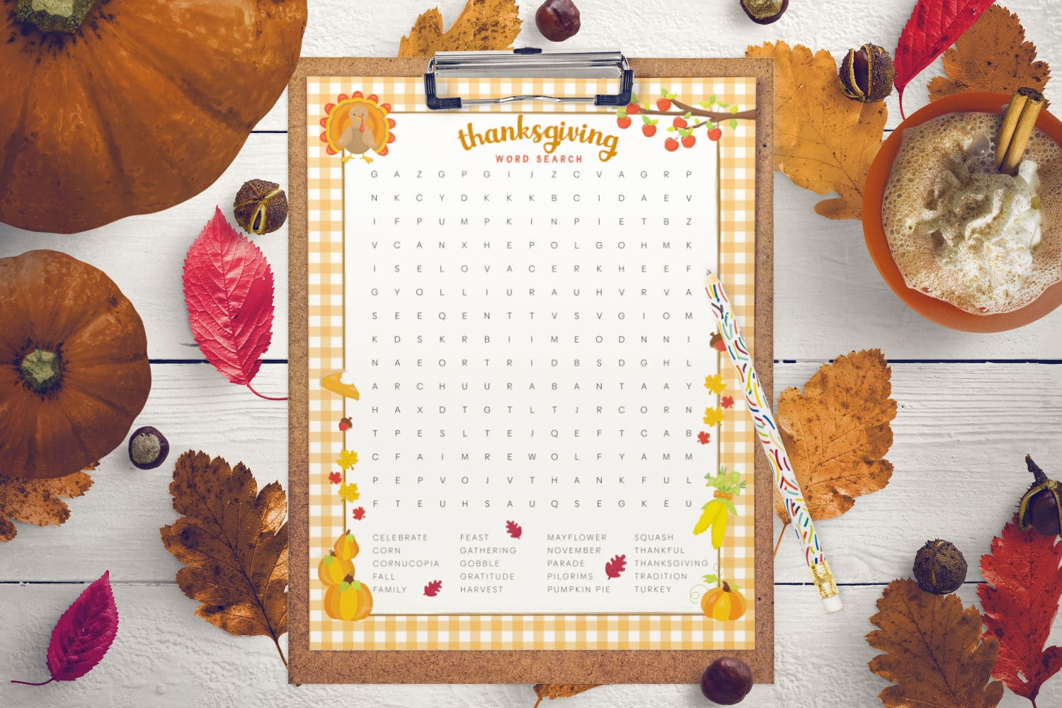 flat lay of the thanksgiving word search on a cork clipboard, surrounded by fall leaves and pumpkins