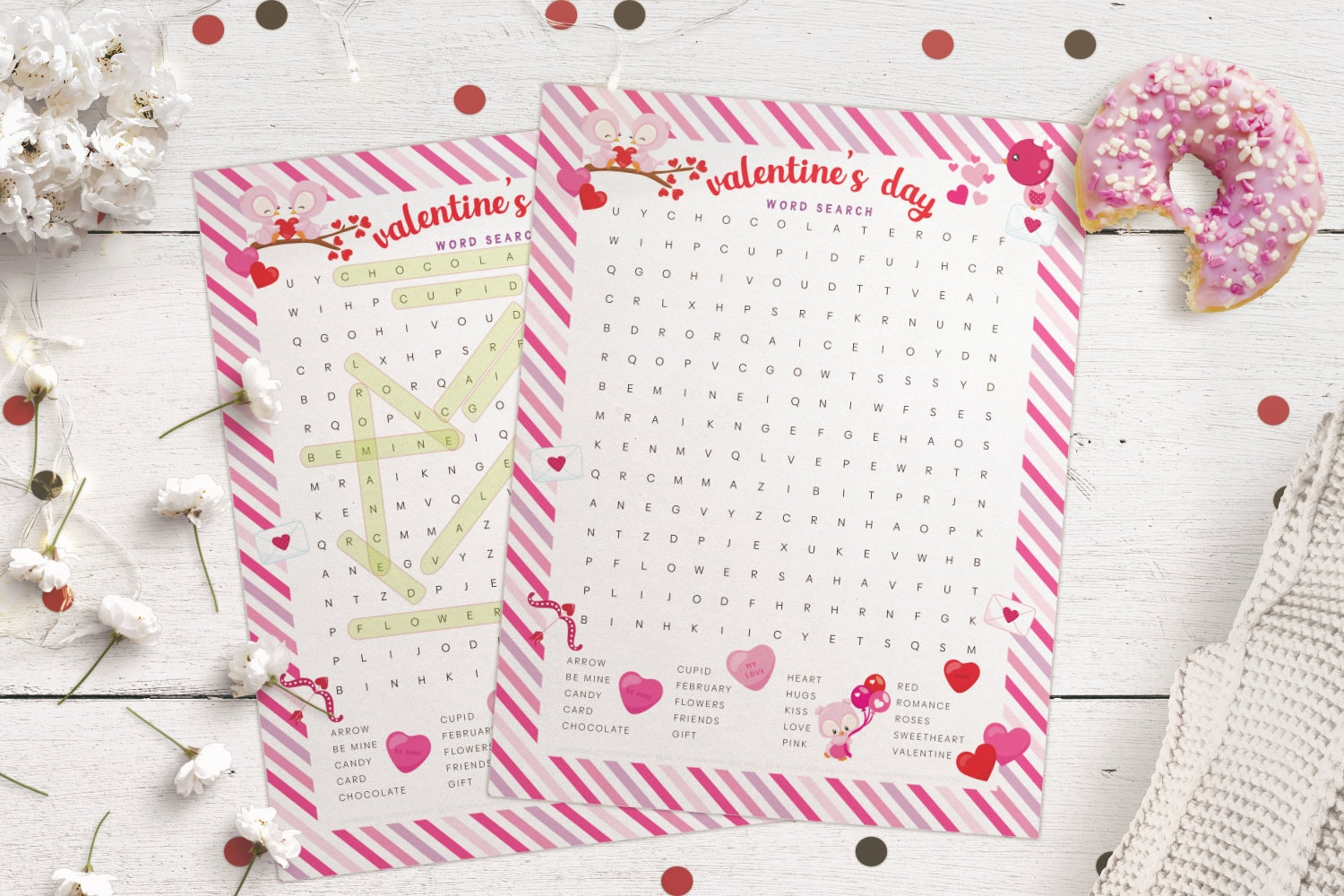 Free printable Valentine's Day word search activity and answer sheet lying on a white wood table
