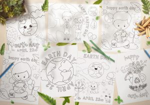 7 Earth Day themed coloring pages spread out on a wood table with green leaves, petals and color pencils scattered around